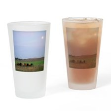 Cows in a moonlit field Drinking Glass