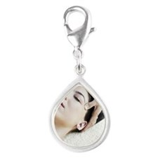 Woman Receiving Facial Silver Teardrop Charm