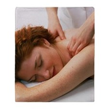 Woman receives a neck and shoulder m Throw Blanket