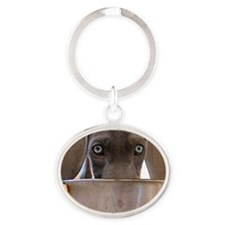 Blue Eyed Weimaraner Eating Oval Keychain