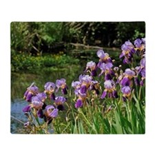 Iris flowers on river bank Throw Blanket