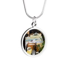 Box of office items on chair Silver Round Necklace