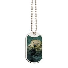 Sea otter Enhydra lutris floating on back Dog Tags