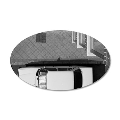 Car parked on street, Madrid 35x21 Oval Wall Decal