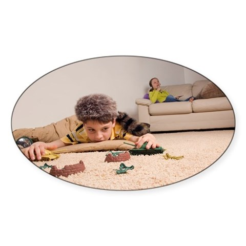 Young boy playing with toys, g Decal