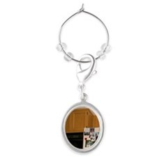 Dog smelling food items in refrige Oval Wine Charm