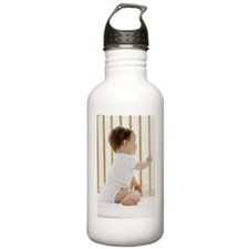 Baby girl in a cot Water Bottle