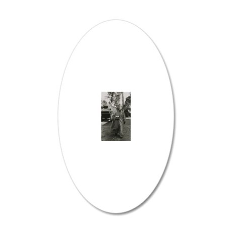 Soldier helping in the clean 20x12 Oval Wall Decal