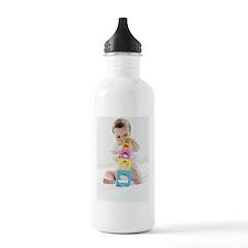 Baby girl playing Water Bottle