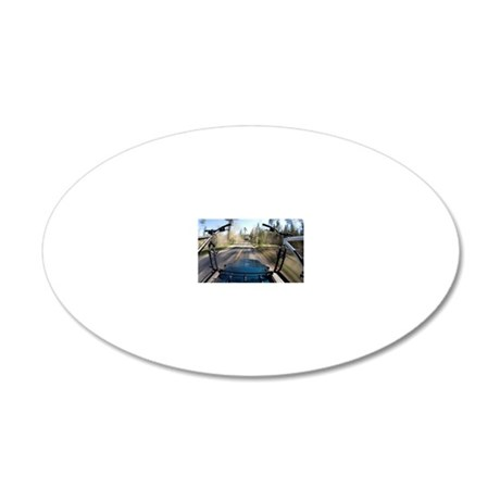 Blurred image of mountain bi 20x12 Oval Wall Decal