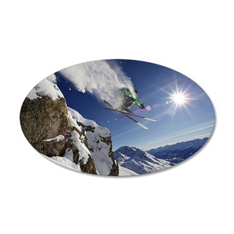 Skier in midair on snowy mou 35x21 Oval Wall Decal