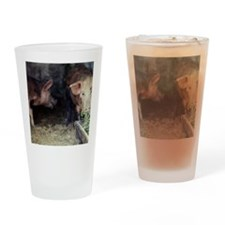 Two pigs eating nettles. Drinking Glass