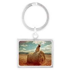Dog sitting on hay bale Landscape Keychain