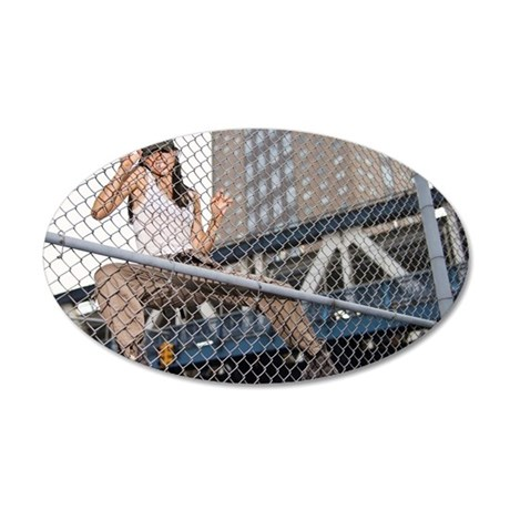 Woman climbing chain link fe 35x21 Oval Wall Decal