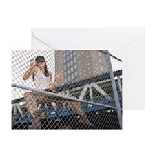 Woman climbing chain link fence Greeting Card