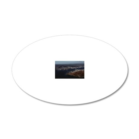 Houses along ocean shore 20x12 Oval Wall Decal