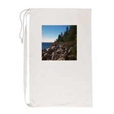 Lighthouse on shore Laundry Bag