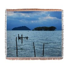 Wooden posts in lake Woven Blanket
