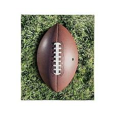 American football on grass Throw Blanket