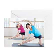 Women doing yoga at a gym Greeting Card
