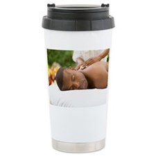 Young man having a back massage Ceramic Travel Mug