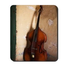 A double bass in the corner of a room Mousepad