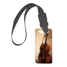 A double bass in the corner of a Luggage Tag