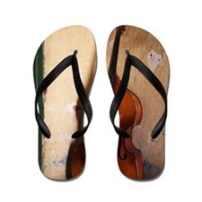 A double bass in the corner of a room Flip Flops