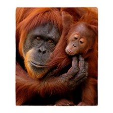 A mother and baby orangutan share a  Throw Blanket