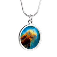 Gas pillars in the Eagle Neb Silver Round Necklace