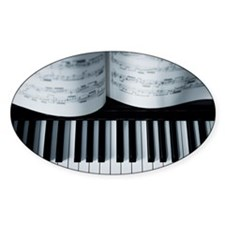 Piano keys and music book detail. Decal