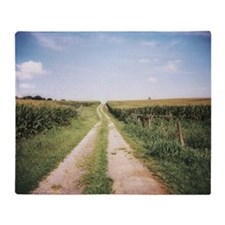 Cornfield and dirt road after harves Throw Blanket