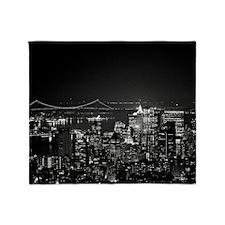 Manhattan, New York City at night wi Throw Blanket