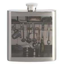 a kitchen counter with utensils kept on it a Flask