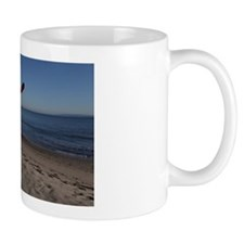 Snowman on the beach with winter hat an Mug