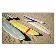 Surfboards lying on sand Decal