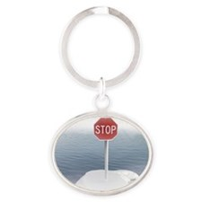 Stop sign on a melting iceberg. Oval Keychain