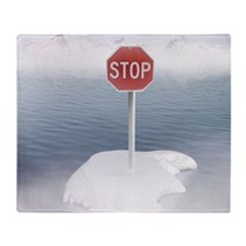 Stop sign on a melting iceberg. Throw Blanket