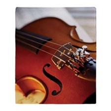 Extreme close-up of violin bridge Throw Blanket