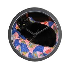 Black cat on pink and blue quilt. Wall Clock