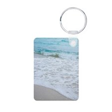 Incoming tide on beach in  Keychains