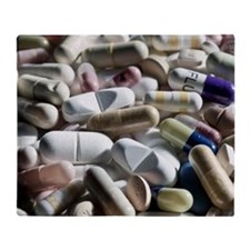 Close up of pile of assorted pills Throw Blanket