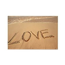 'Love' sand written on the beach  Rectangle Magnet