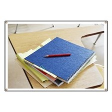 Schoolbooks on desk Banner