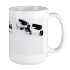 2 men shaking hands at office Mug