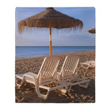 Sun Umbrellas And Beach Beds On A Be Throw Blanket