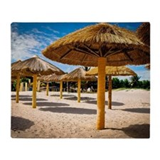 Beach umbrellas of palm fronds Throw Blanket