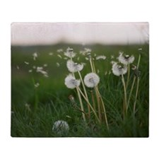 Dandelions blowing in the wind. Throw Blanket