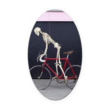 skeleton on a bike. Oval Car Magnet