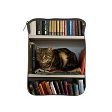 Cat lying on bookshelf iPad Sleeve